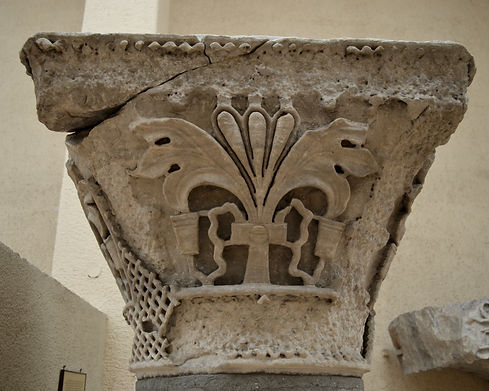 Basket capital with split-palmette from