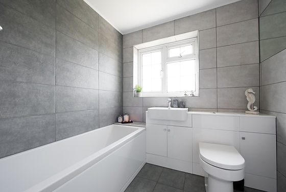 A grey and white modern bathroom suite