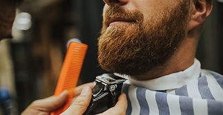 Man getting his beard trimmed using clippers_edited.jpg