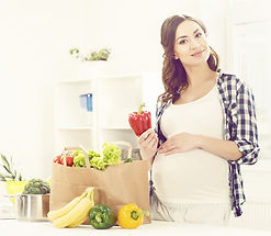 Beautiful pregnant woman with shopping b