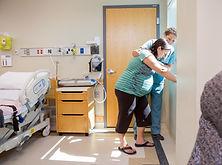 Mid adult female nurse comforting tensed