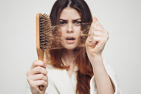 girl with a comb and problem hair on whi