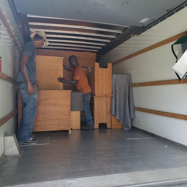 Men unloading truck