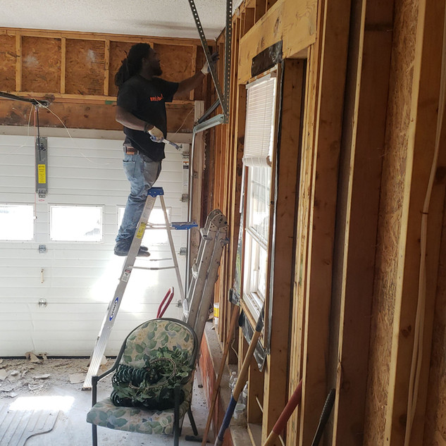 Man working at Need Labor? job site