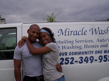 Corey Purdie with wife, Tiffany Purdie, in front of first Miracle Wash Mobile Unit