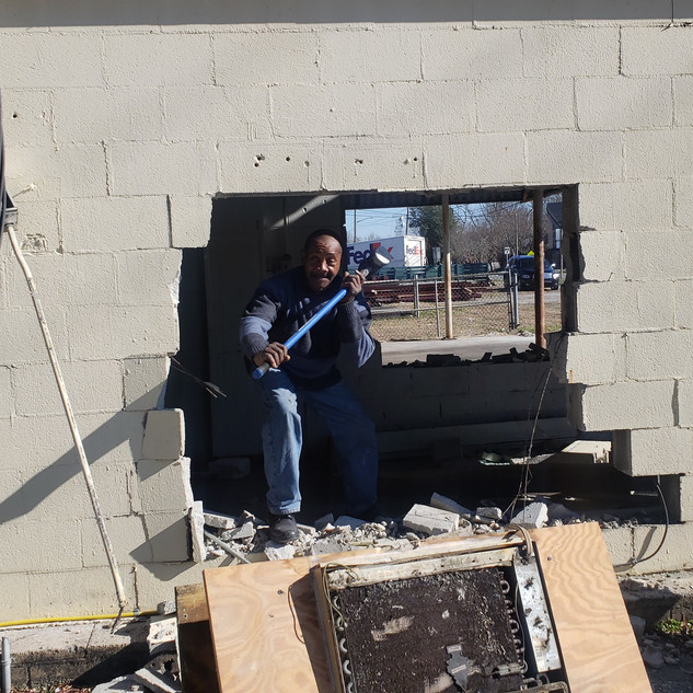 Man working on renovation at Need Labor? job site