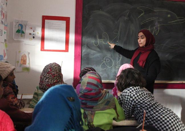 שעור בית ספר לפליטים ביוון