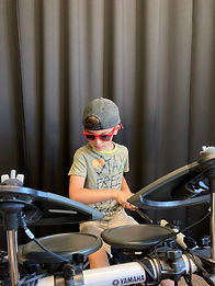 Drum lessons boy with sunglasses