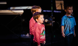 young singers on microphone