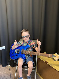 Brody Guitar Lesson with blue guitar