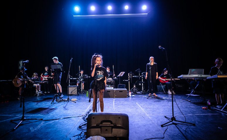Young musicians on stage in Salford