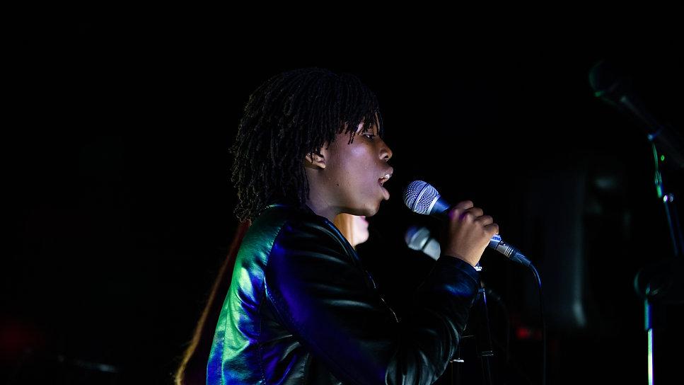 Singer at concert in Manchester