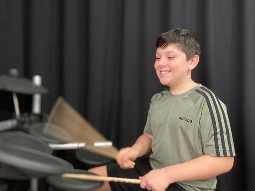 Teenage drummer learning a song