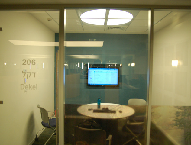 Unique light fixture above a computer corner