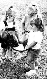 Girls Feeding Pony B&W