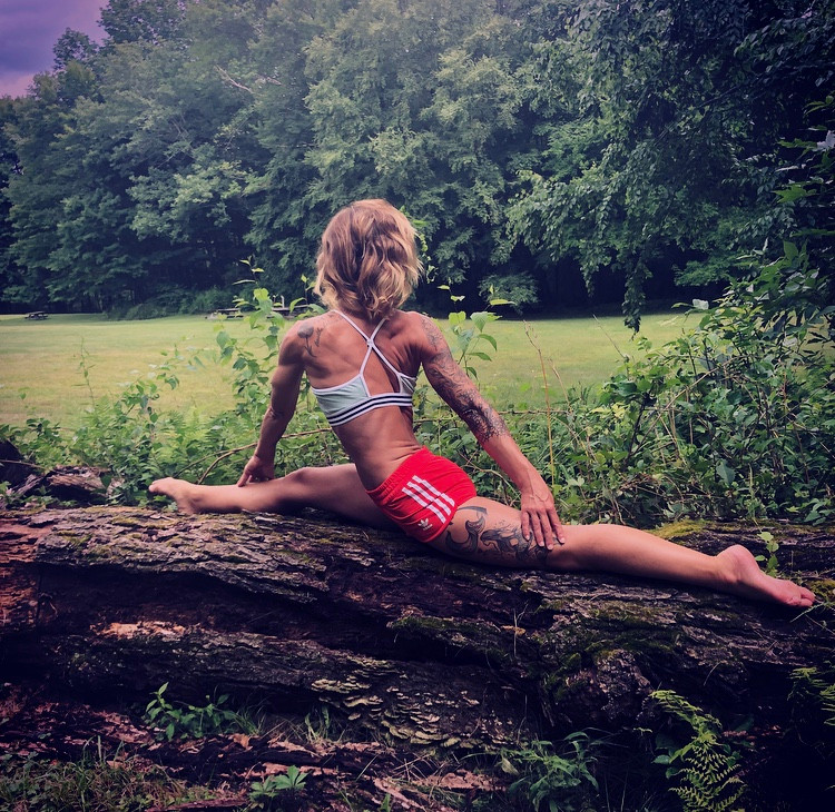 Yoga teacher Gina Mandella practicing hanumanasana - monkey pose