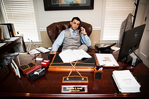 Ibrahim J. Awad working in his office at The Awad Law Firm, P.C.