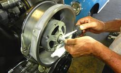 Anti seize being properly applied to Porsche engine's alternator shaft by George Perdomo