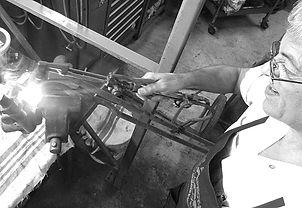 George Perdomo with torch in hand heating a Porsche part