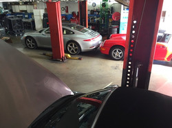3 porsches parked in gp autowerks garage for repair, service, and a rebuild