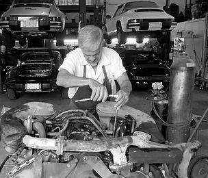 George Perdomo repairing Porsche engine exhaust