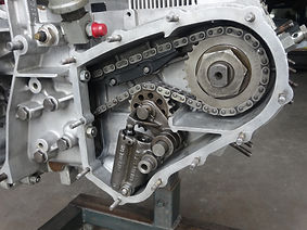miami porsche engine right side chain tensioner housing with chain, tensioner, and chain ramps installed