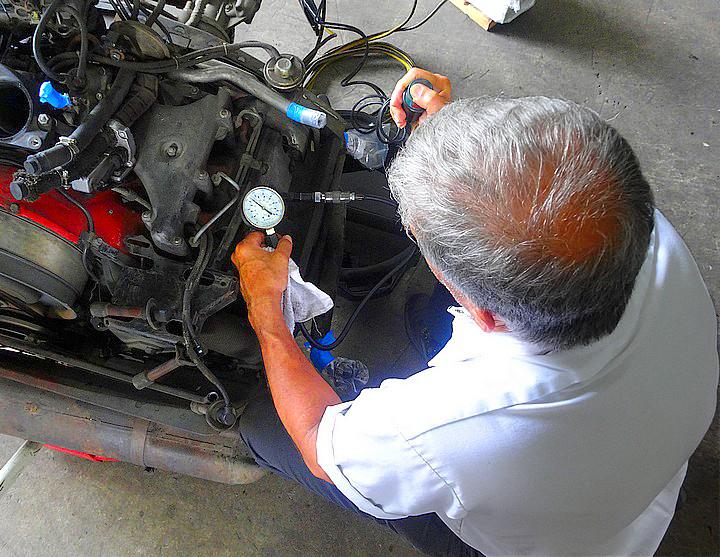 George Perdomo preforming a compression test on Porsche engine