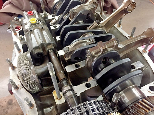 Porsche crankshaft is being inspected while it sits in engine case