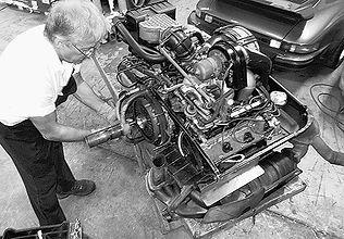 George Perdomo removing engine stand from rebuilt Porsche engine