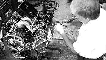 George Perdomo installing valve cover on Porsche engine