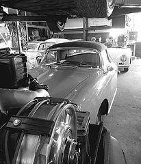 George Perdomo's workshop with Porsche 911 engine in foreground and two Porsche 356s behind