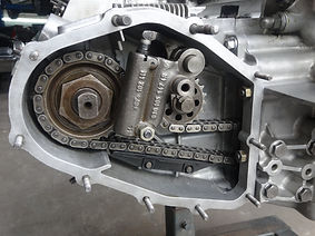 Porsche engine left side chain tensioner housing with chain, tensioner, and chain ramps installed