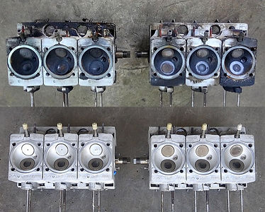 Two photos together - top is dirty Porsche engine heads, bottom is same Porsche engine heads cleaned