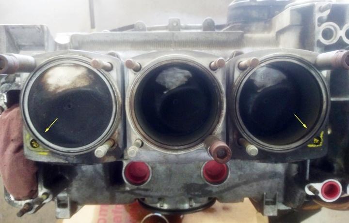 Porsche engine with 4 broken head studs is being repaired