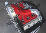 Porsche 930 engine with original, red air cooling shroud being the focal point