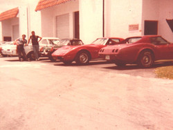 Historical photo: corvettes and midget outside george perdomo's river shop in 1975