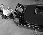 black porsche 356 being worked on by george perdomo