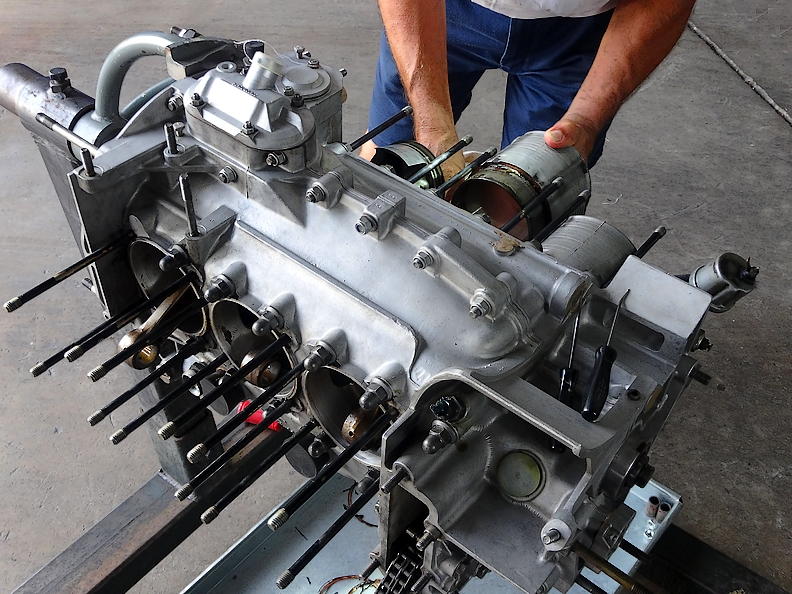 Porsche engine during rebuild when cylinders are being pulled by George Perdomo