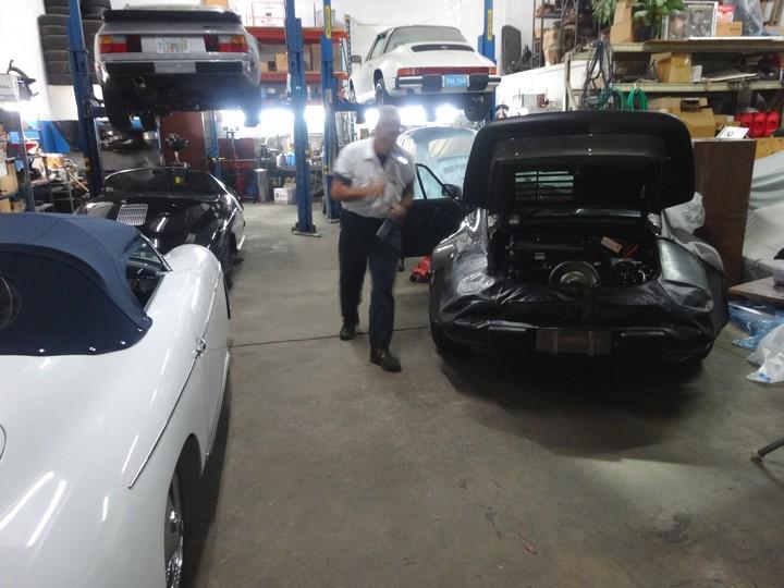 Night shift at George Perdomo's Porsche service, repair and & rebuild shop in Miami