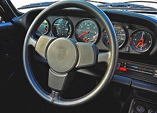 Restored 1979 Porsche model 930 steering wheel newly recovered in full grain black leather