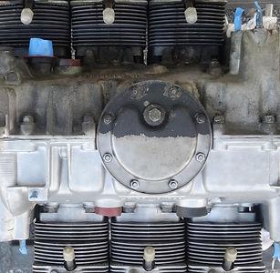 porsche engine showing half blasted clean and half dirty in miami porsche shop of gp autowerks