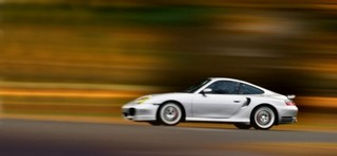silver miami porsche against a blurred background