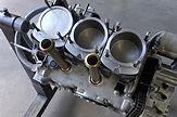 miami porsche on gp autowerks engine stand showing piston tops