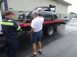 Porsche 356 replica on flatbed arrives with ignition and handling issues