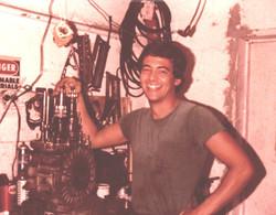 Historical photo: george perdomo restoring porsche 930 transmission in 1979