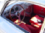 A 1954 Porsche 356's interior is seen. This is compared to a Porsche 918 interior. For many, the styling of Porsche's classic cars like the 356 is timeless.