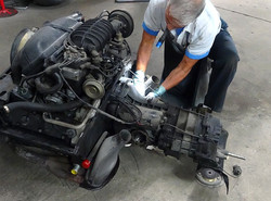 Porsche engine with nearly 300,000 miles is removed from car and being prepared by George Perdomo fo