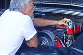 george perdomo adjusting air fuel flow to miami porsche at his shop