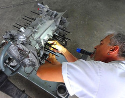 George Perdomo inspecting Porsche engine rod bearings for play