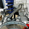 Link to Porsche services subpage: handling | porsche suspension including strut, arms, and top of vented brake disk